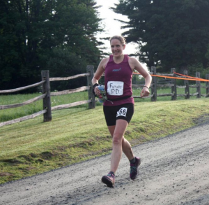 Amy during a race, running along the gravel and dirt roads of Vermont