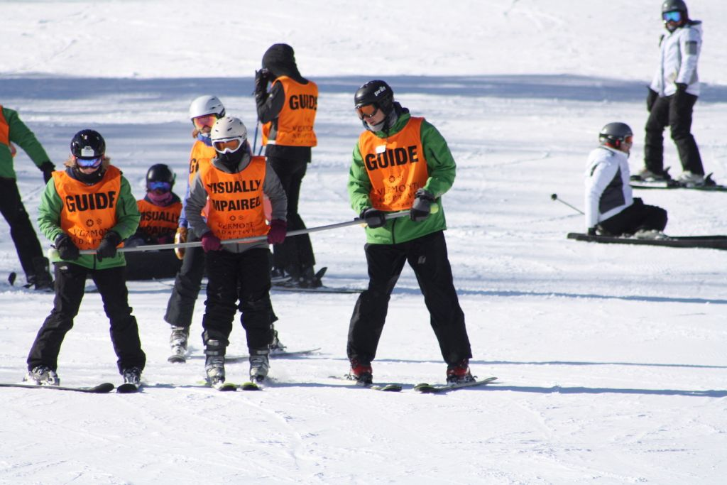 A visually impaired skiers works with two Vermont Adaptive guides at the 13th Annual USABA / Vermont Adaptive Ski Festival Weekend