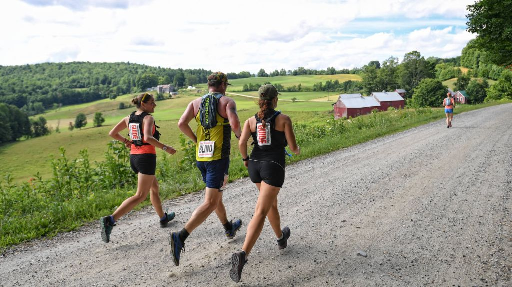 2 Guides and a Blind Athlete Race Along the VT100's Dirt Roads with Fields on Their Left
